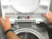 Position the toilet seat on the mounting hinges when the toilet seat is in the open position. Firmly press down on the hinges making sure they are in position. Close the toilet seat making sure not to lift the toilet seat out of position.